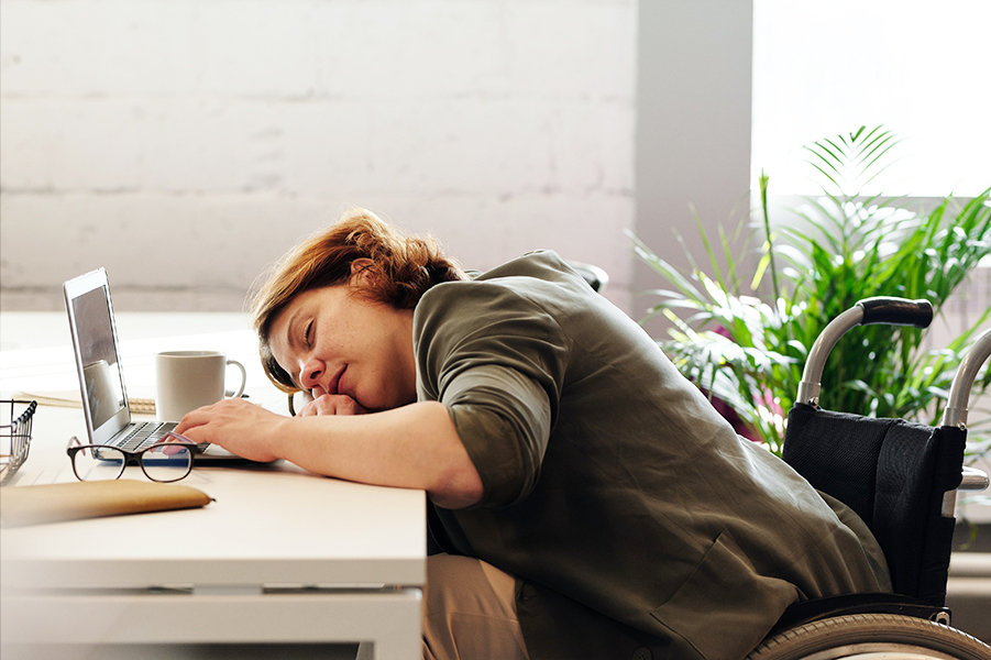 Lady sleeping on desk